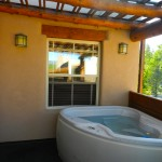 304 One Bedroom Outside the room is a accessible jacuzzi
